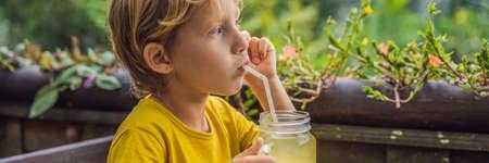 Boy drinking juice in a cafe.