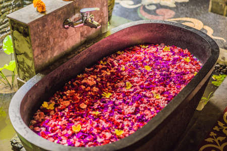 Spa petals in bowl with tropical flowers, spa pedicure treatment