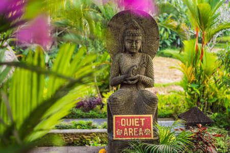 A sign QUIET AREA in a quiet corner of the garden
