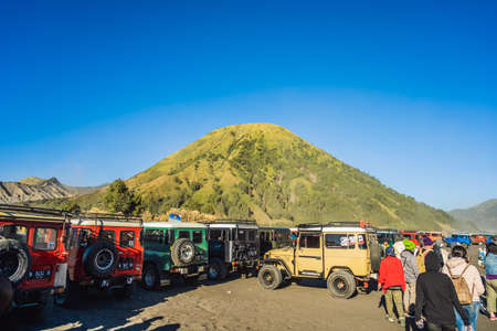 07.22.19 Indonesia, Java: An offroad cars parking close to the Bromo volcano inside of a so-called Sea of sand inside the Tengger caldera at the Bromo Tengger Semeru National Park in the Java Island, Indonesia. One of the most famous volcanic objects in t Editorial
