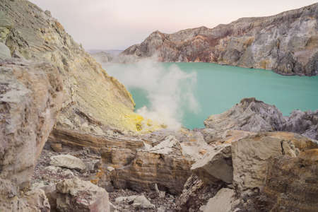 The Ijen volcano or Kawah Ijen on the Indonesian language. Famous volcano containing the biggest in the world acid lake and sulfur mining spot at the place where volcanic gasses come from the volcano