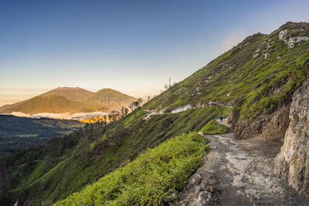 The magnificent views on green mountains from a mountain road trecking to the Ijen volcano or Kawah Ijen on the Indonesian language.