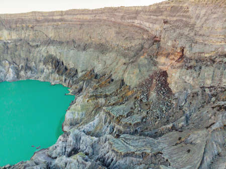 Aerial shot of the Ijen volcano or Kawah Ijen on the Indonesian language. Famous volcano containing the biggest in the world acid lake and sulfur mining spot at the place where volcanic gasses come from the volcano Reklamní fotografie