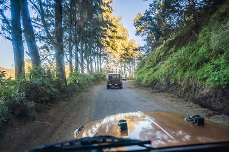 View from the inside of an offroad car riding down the road at the Bromo Tengger Semeru National Park on the Java Island, Indonesia. One of the most famous volcanic objects in the world. Travel to Indonesia concept