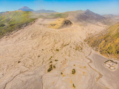 Aerial shot of the Bromo volcano and Batok volcano at the Bromo Tengger Semeru National Park on Java Island, Indonesia. One of the most famous volcanic objects in the world. Travel to Indonesia concept