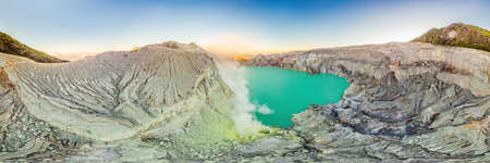 Aerial panoramic shot of the Ijen volcano or Kawah Ijen on the Indonesian language. Famous volcano containing the biggest in the world acid lake and sulfur mining spot at the place where volcanic gasses come from the volcano Reklamní fotografie