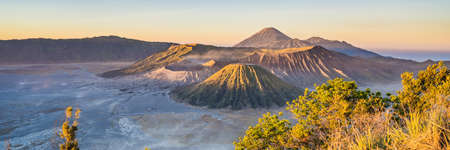 BANNER, LONG FORMAT Sunrise at the Bromo Tengger Semeru National Park on the Java Island, Indonesia. View on the Bromo or Gunung Bromo on Indonesian, Semeru and other volcanoes located inside of the Sea of Sand within the Tengger Caldera. One of the most famous volcanic objects in the world. Travel to Indonesia concept