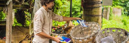 Man separately picks up trash. Separate garbage collection concept BANNER, LONG FORMAT