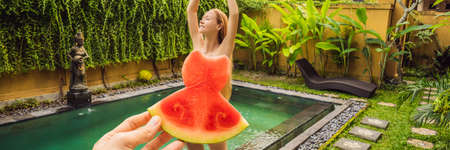Young woman in a watermelon dress on a pool background. The concept of summer, diet and healthy eating BANNER, LONG FORMAT