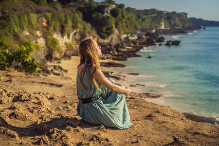 Young woman tourist on Pantai Tegal Wangi Beach, Bali Island, Indonesia. Bali Travel Concept Reklamní fotografie