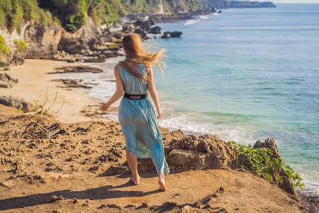 Young woman tourist on Pantai Tegal Wangi Beach, Bali Island, Indonesia. Bali Travel Concept Zdjęcie Seryjne