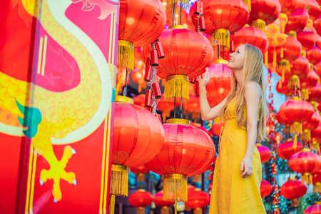 Woman celebrate Chinese New Year look at Chinese red lanterns. Chinese lanterns