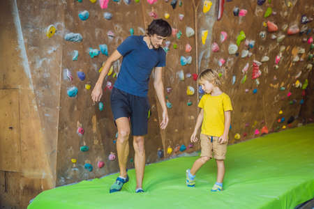 Dad and son at the climbing wall. Family sport, healthy lifestyle, happy family