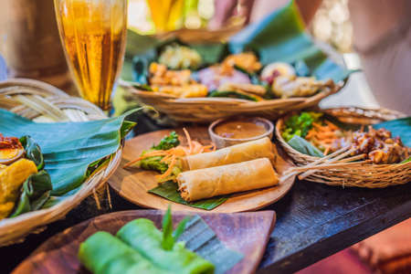 Fried spring rolls served with salad and sauce. Traditional Indonesian and Asian dish