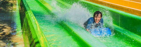 Dad and son have fun at the water park BANNER, LONG FORMAT Stock Photo