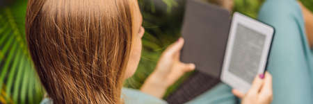Woman reads e-book on deck chair in the garden BANNER, LONG FORMAT