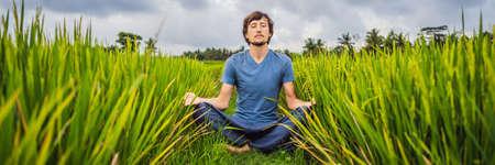 Man doing yoga in a rice field BANNER, LONG FORMAT Banco de Imagens