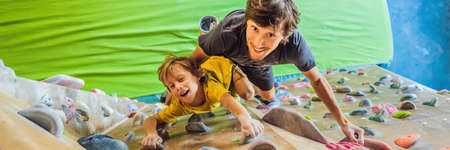 Dad and son at the climbing wall. Family sport, healthy lifestyle, happy family BANNER, LONG FORMAT