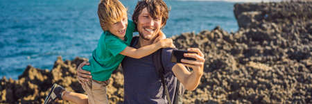 Father and son travelers on amazing Nusadua, Waterbloom Fountain, Bali Island Indonesia. Traveling with kids concept BANNER, LONG FORMAT Banco de Imagens