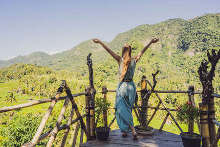 Young woman tourist on background of Tropical jungle of bali. Forest and mountain. Bali Travel Concept.