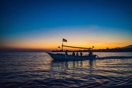 Bali, Indonesia, August 17, 2019 morning sun in Bali, Indonesia. Traditional fishing boats Bali, Indonesia