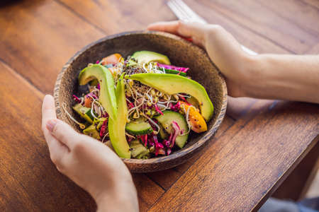 Mixed Green Salad with Quinoa and Avocado on Wood Background Healthy Food Concept. Vegetarian food concept
