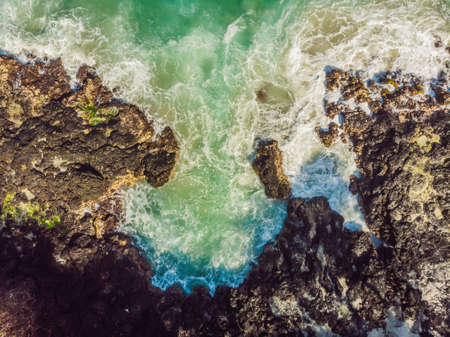Aerial view of sea waves and fantastic Rocky coast.
