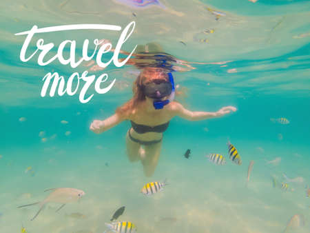 TRAVEL MORE concept Happy woman in snorkeling mask dive underwater with tropical fishes in coral reef sea pool. Travel lifestyle, water sport outdoor adventure, swimming lessons on summer beach holida