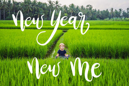 NEW YEAR NEW ME concept Little boy practices yoga in a rice field, outdoor. Gymnastic exercises NEW YEAR NEW ME concept
