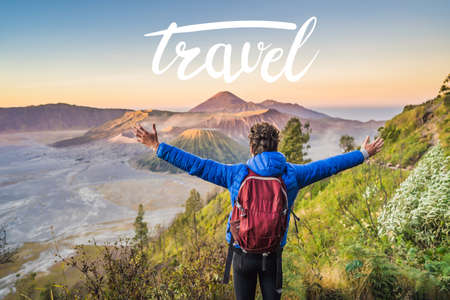 TRAVEL MORE concept Young man meets the sunrise at the Bromo Tengger Semeru National Park on the Java Island, Indonesia. He enjoys magnificent view on the Bromo or Gunung Bromo on Indonesian, One of the most famous volcanic objects in the world. Travel to Indonesia concept