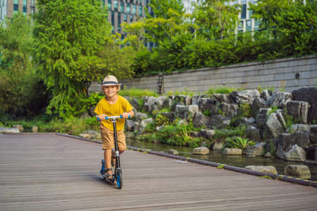 Scooter boy in Seoul. Cheonggyecheon stream in Seoul, Korea. Cheonggyecheon stream is the result of a massive urban renewal project. Travel to Korea Concept. Traveling with children concept