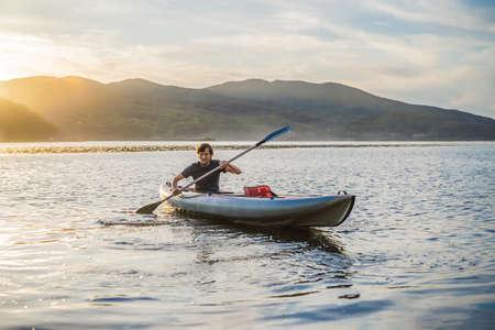 Summer Travel Kayaking. Man Paddling Transparent Canoe Kayak, Enjoying Recreational Sporting Activity. Male Canoeing With Paddle, Exploring Sea On Vacation. Rowing Water Sports Stockfoto - 134859543