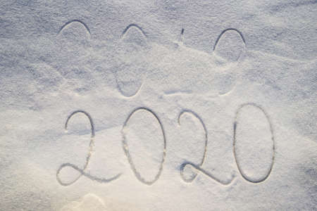 New Year 2020 is coming concept - inscription 2019 and 2020 snow almost fell asleep 2019 inscription