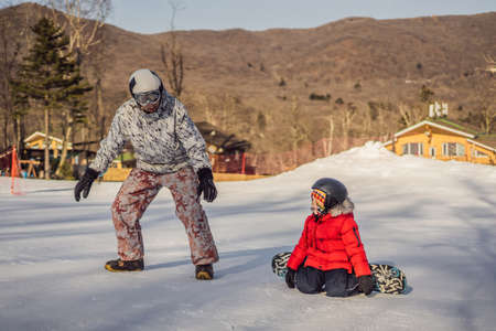 Little cute boy snowboarding. Activities for children in winter. Children's winter sport. Lifestyle.