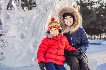 Mother and son enjoying beautiful winter day outdoors Stock Photo - 136713726