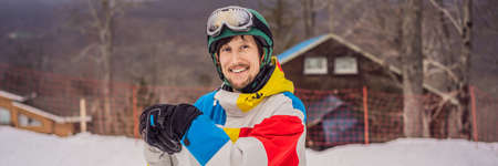 Male snowboarder at a ski resort in winter BANNER, LONG FORMAT
