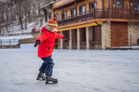 Boy ice skating for the first time.