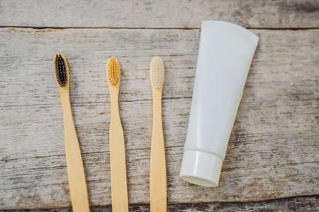 Zero waste concept. Bamboo toothbrush on wooden background. Plastic free essentials, teeth care. Sustainable lifestyle