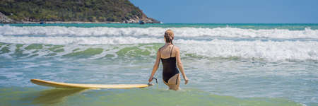 BANNER, LONG FORMAT Beautiful young woman ride wave. Sporty surfer woman surfing on the background of blue sky, clouds and transparent waves. Outdoor Active