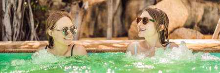 Portrait of two beautiful women in hot tub spa BANNER, LONG FORMAT