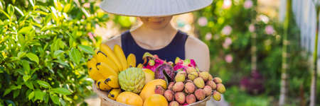 Variety of fruits in a Vietnamese hat. Woman in a Vietnamese hat. BANNER, LONG FORMAT