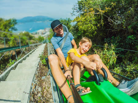 Father and son on the alpine coaster Standard-Bild - 147682738