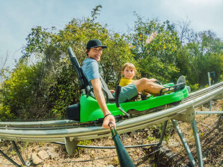 Father and son on the alpine coaster Standard-Bild - 147697499