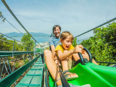 Father and son on the alpine coaster Standard-Bild - 147684776
