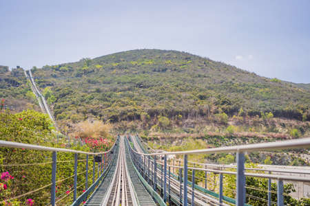 Rail downhill on a trolley, Point of view during a ride on Alpine Coaster on rails Standard-Bild - 148891655