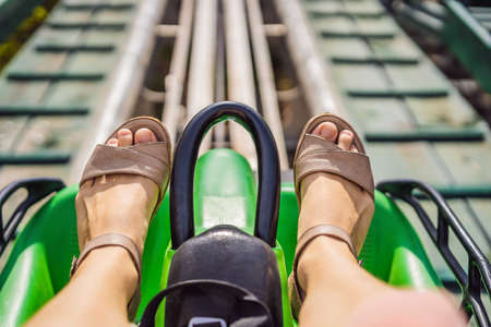 Rail downhill on a trolley, Point of view during a ride on Alpine Coaster on rails Standard-Bild