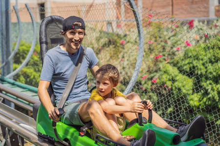 Father and son on the alpine coaster Standard-Bild - 148954197