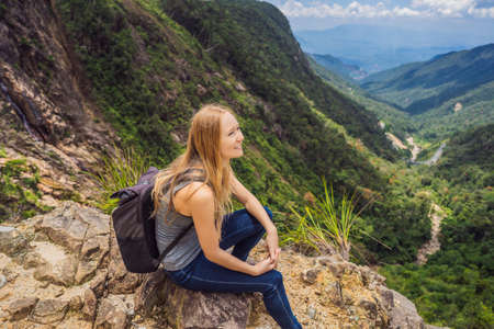 Woman hiker on a rock. View of the valley from the cliff, Vietnam, Da Lat