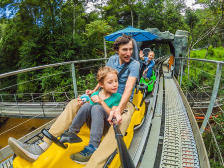 Father and son on the alpine coaster Standard-Bild - 150372884