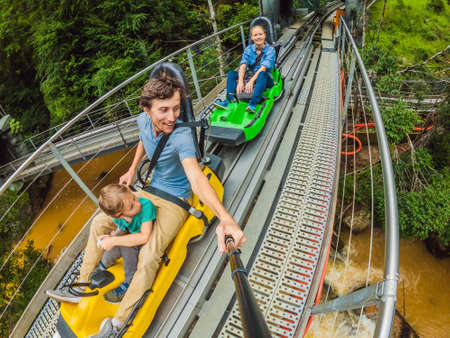 Father and son on the alpine coaster Standard-Bild - 150375606
